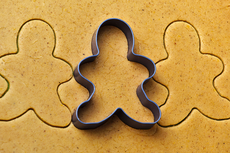 Christmas gingerbread men cookies making with metal cutter 스톡 콘텐츠