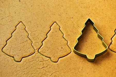 Christmas tree gingerbread cookies baking with metal cutter 스톡 콘텐츠