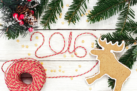 Happy New year 2016, numbers maden by wrapping thread of yarn on wooden background with Christmas decorations Stok Fotoğraf - 49373284