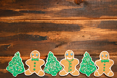 Christmas Gingerbread cookies on brown wooden background 스톡 콘텐츠