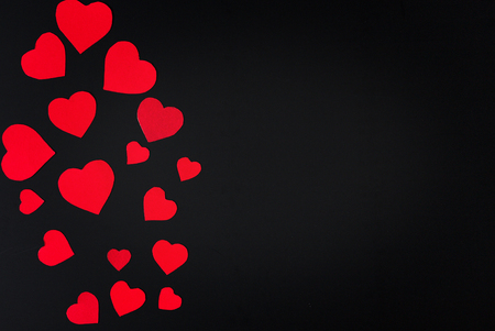 Red heart paper cut on black background. Valentines day.