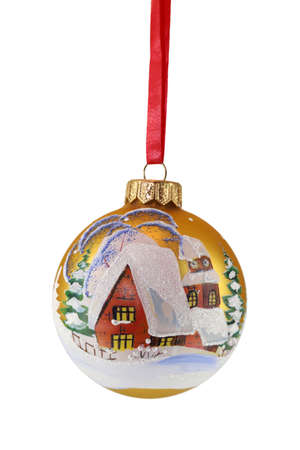 golden christmas ball with house and red ribbon photo