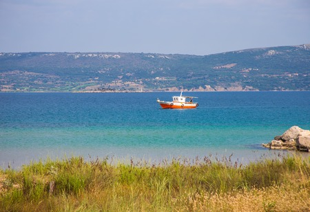 messinia: seascape with fisherman boat.