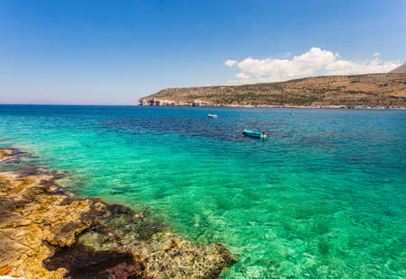 messinia: seascape with small fisherman boat