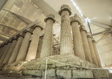 Large columns of the Apollo temple at Bassae covered with large canopy, Greece