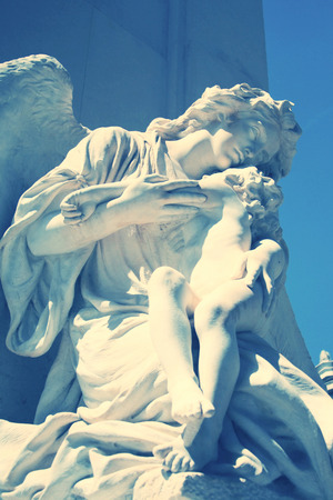 angel cemetery: Statue angel and child on the tomb. First cemetery in Athens, G Stock Photo