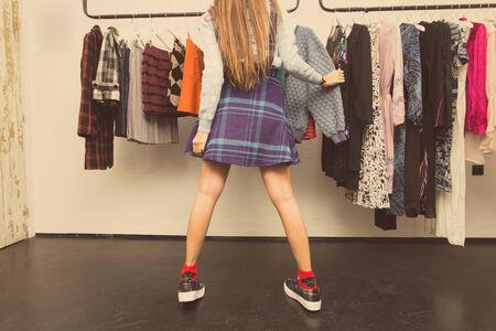 checkered skirt: legs of woman wearing blue checkered skirt