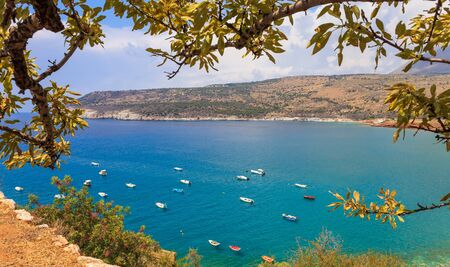 messinia: summer seascape with small blue fishernan boats Stock Photo