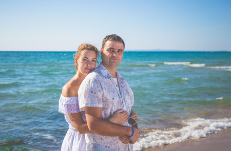enamored man and woman posing in different places Stock Photo