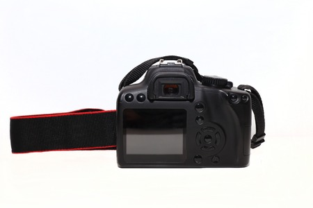 digicam: Closeup image of black digital photo camera with empty display for your picture or text, isolated on white background