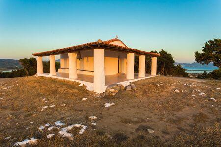 messenia: little church of Prophet Ilias druing sunset near Pylos, Messenia, Greece Stock Photo