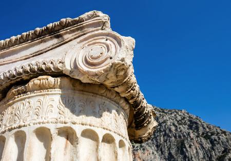 delphi: capital of Ionian order column in Ancient Delphi, Greece