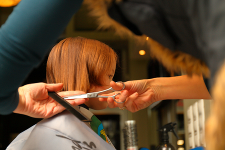 First haircut of little girl  in professional  hair salon