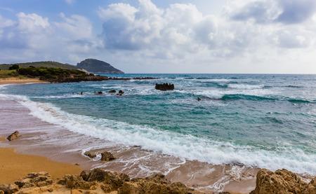 messenia: seascape with foamy waves swashing on the beach