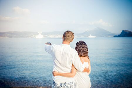 Back view, couple hug on boat marine background. Travel and adventure concept idea