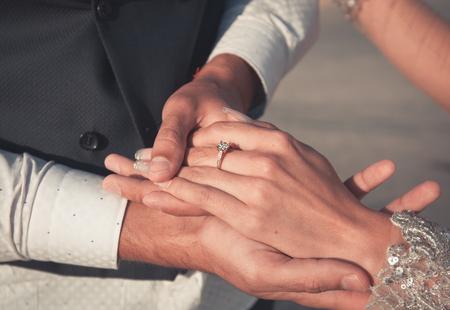 wedding couple holding hands, happy groom and bride