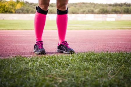 female legs wearing sport equipment Stock Photo