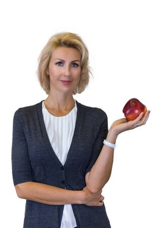 business portrait of a nutritionist caucasian female with apple on white background Stock Photo