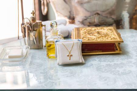 Accessories of a priest with Oil bottle for Christian baptism