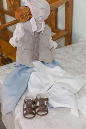 greek Orthodox christening objects - baby clothes, shoes, baptism oil, soap and candles