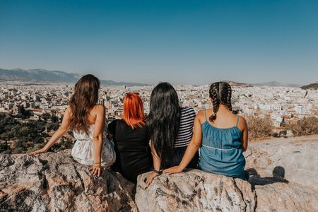 women enjoying the fantastic view from the outlook mountain Areopagus overseeing Athens, Greece