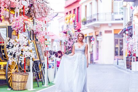 bride in a street with flowers Stock Photo
