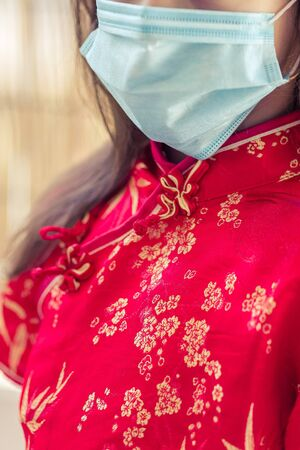 Children in traditional chinese dress in medicine mask. Coronavirus. Kid girl imprison at home for protection corona virus.coronavirus and epidemic virus symptoms.