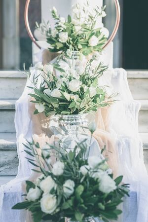 The floral wedding decoration in the entrance of church Stock Photo