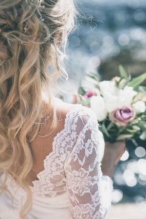 Bride in luxury wedding dress back Stock Photo
