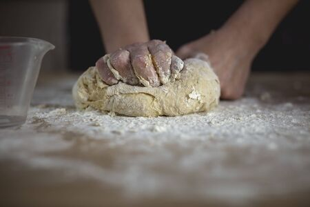 woman hands kneading bread dough Stock Photo