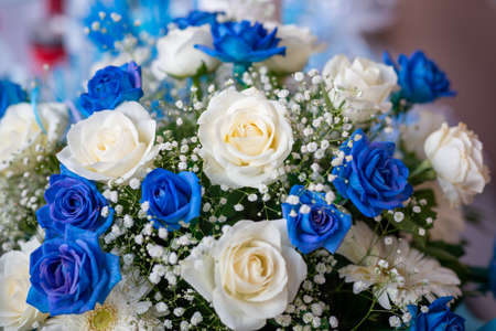 wedding bouquet of blue and pink roses