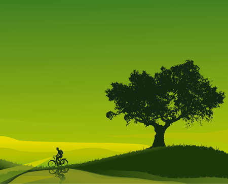 Idyllic sunset in shades of green with a cyclist who walks beside a river
