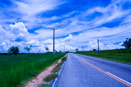 Asphalt road near Trinidad, Cuba, going to horizon Stock Photo