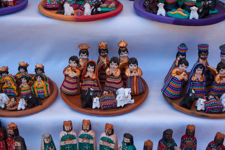 Christmas figurines for sale at Chichicastenango market Guatemala photo