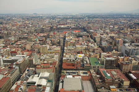 Mexico city aerial view with mountains and clouds DF photo