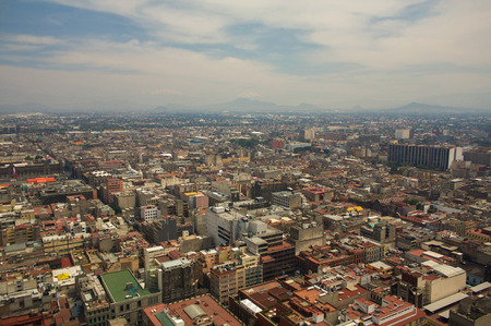 aerial view city: Mexico city DF aerial view with mountains and clouds