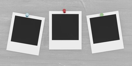 three square blank empty photocards pinned on grey wall background with coloured pins Imagens