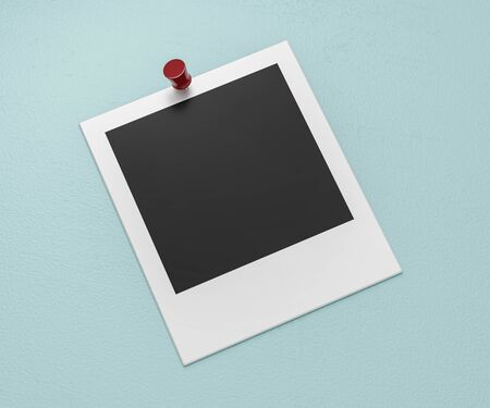 square blank empty photo card pinned on cyan wall background with red coloured pin Imagens