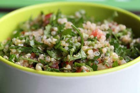 A bowl of Lebanese quinoa tabbouleh. Stock Photo
