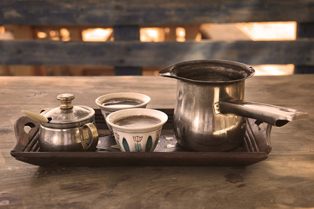 A tray with two Lebanese traditional coffee cups with a Turkish coffee Kettle. Stock Photo