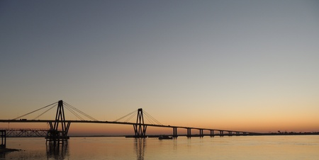 corrientes: sunset behind the bridge on Parana river