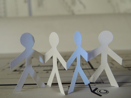 conformation: silhouette of four people on a project plan Stock Photo