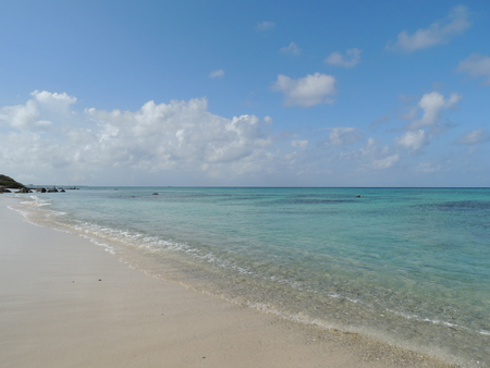 deserted beach with crystal clear water