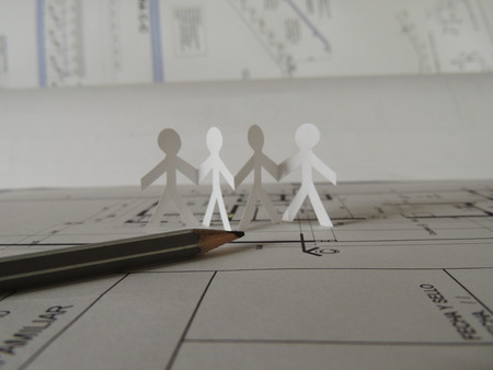 deduce: silhouette of four people and a pencil on a project plan Stock Photo