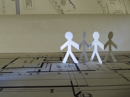 split level: silhouette of four people on a project plan Stock Photo
