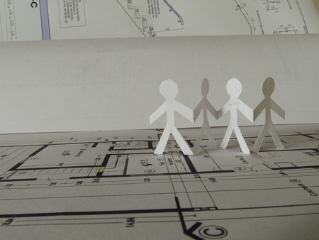 body dimensions: silhouette of four people on a project plan Stock Photo