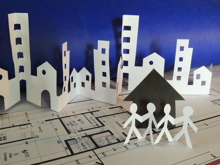 housing lot: Real estate concept made on cutted paper over aa city map