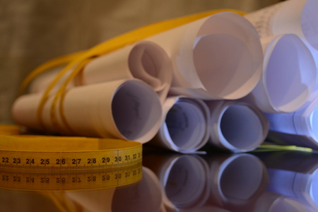 scheming: project rolled papers with tape measure around 12