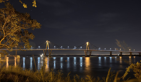 night cityscape of Manual Belgrano Bridge on Parana river, Corrientes, Argentina