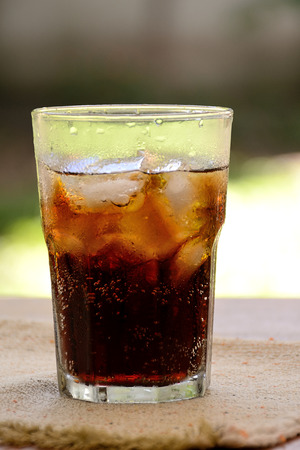 beveragge fresh cola in a glass on an Individual matel